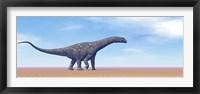 Large Argentinosaurus dinosaur walking in the desert Framed Print