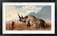 Framed marmot approaches an old and grey woolly rhinocerous
