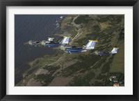 Framed Saab 105 jets flying in formation