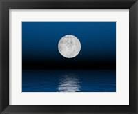 Framed Beautiful full moon against a deep blue sky over the ocean