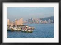 Framed Kowloon ferry terminal and clock tower, Hong Kong, China
