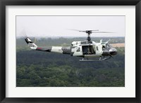 Framed US Air Force UH-1H Huey in an experiment paint scheme