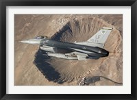 Framed F-16C Fighting Falcon flying above Arizona's Meteor Crater