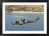 Framed Italian Air Force AB-212 ICO helicopter in flight over Italy