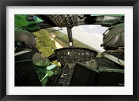 Framed Two instructor pilots practice low flying operations in a UH-1H Huey helicopter