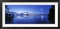 Framed Moon rising over tranquil lake against moody sky, Mozhaisk, Russia