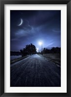 Framed road in a park at night against moon and moody sky, Moscow, Russia