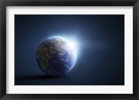 Framed Planet Earth and sunlight on a dark blue background