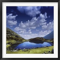 Framed Blue lake in the Pirin Mountains over tranquil clouds, Pirin National Park, Bulgaria