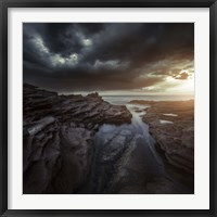 Framed Huge rocks on the shore of a sea against stormy clouds, Sardinia, Italy