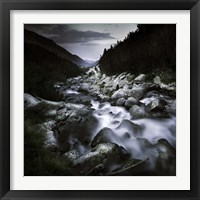 Framed Small river flowing over large stones in the mountains of Pirin National Park, Bulgaria