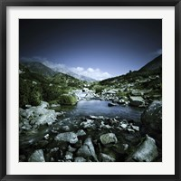 Framed Small river flowing through big stones in Pirin National Park, Bulgaria