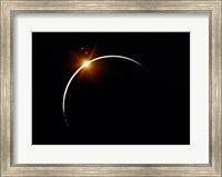 Framed Apollo 12 view of a solar eclipse