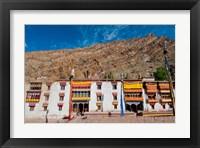 Framed Hemis Monastery facade with craggy cliff, Ladakh, India