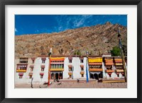 Framed Hemis Monastery facade with craggy cliff, Ladakh, India