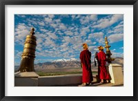 Framed Monks playing horns at sunrise, Thiksey Monastery, Leh, Ledakh, India