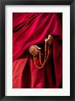 Framed Hands of a monk in red holding prayer beads, Leh, Ladakh, India