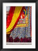 Framed Monks raising a thangka during the Hemis Festival, Ledakh, India