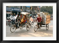 Framed People and cargo move through streets via rickshaw, Varanasi, India