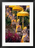 Framed Statues at Mother Temple Adorned in Yellow, Indonesia