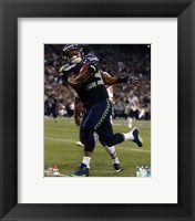 Framed Earl Thomas 2014 with the ball