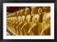 Framed Taiwan, Foukuangshan Temple, Standing gold-colored Buddha statues at a Buddhist shrine
