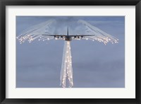 Framed MC-130H Combat Talon Dropping Flares
