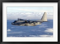 Framed MC-130P Combat Shadow Soars Above the Clouds
