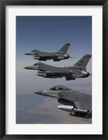 Framed Three F-16's fly in Formation over Arizona (vertical)