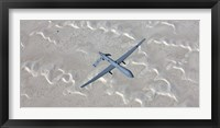 Framed MQ-1 Predator Flies over the White Sands National Monument, New Mexico