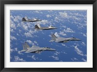 Framed F-15 Eagles and F-22 Raptors Fly in Formation