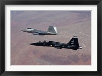 Framed F-22 Raptor and T-38 Talon Fly in Formation over New Mexico