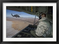Framed Loadmaster on an HC-130 Watches a HH-60G Pave Hawk Refuel