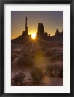 Framed Sunburst through the Totem Polein Monument Valley, Utah