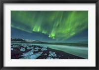 Framed Aurora Borealis over the Ice Beach near Jokulsarlon, Iceland