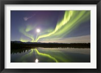 Framed Aurora Borealis and Full Moon over the Yukon River, Canada
