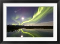 Framed Aurora Borealis and Full Moon over the Yukon River, Canada