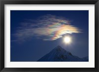 Framed Full Moon with Rainbow Clouds at Ogilvie Mountains