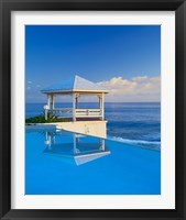 Framed Gazebo reflecting on pool with sea in background, Long Island, Bahamas