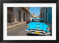Framed Cuba, Camaquey, Oldsmobile car and buildings