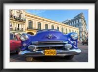 Framed 1950's era car parked on street in Havana Cuba