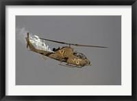 Framed AH-1S Tzefa of the Israeli Air Force dispenses flares