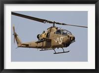 Framed AH-1S Tzefa helicopter in flight