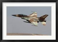Framed F-16B Netz of the Israeli Air Force in flight over Israel