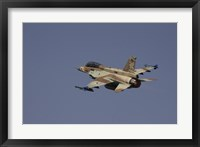 Framed F-16D Barak of the Israeli Air Force flying over Israel