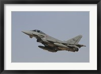 Framed Eurofighter Typhoon of the Italian Air Force taking off