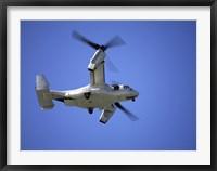 Framed Osprey tiltrotor aircraft in flight