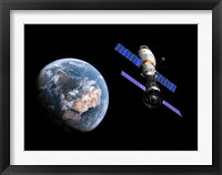 Framed manned Soyuz TMA-M spacecraft docked with an extended stay module