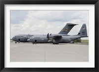 Framed C-130J Super Hercules with a C-17 Globemaster