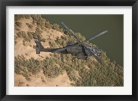 Framed AH-64D Apache Helicopter in Flight